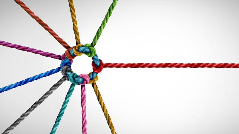 Multiple threads of different colors interweaving in a bond to form a tight-knit circle.