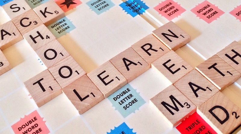 Scrabble letters that spell out school, learn, math, to, read
