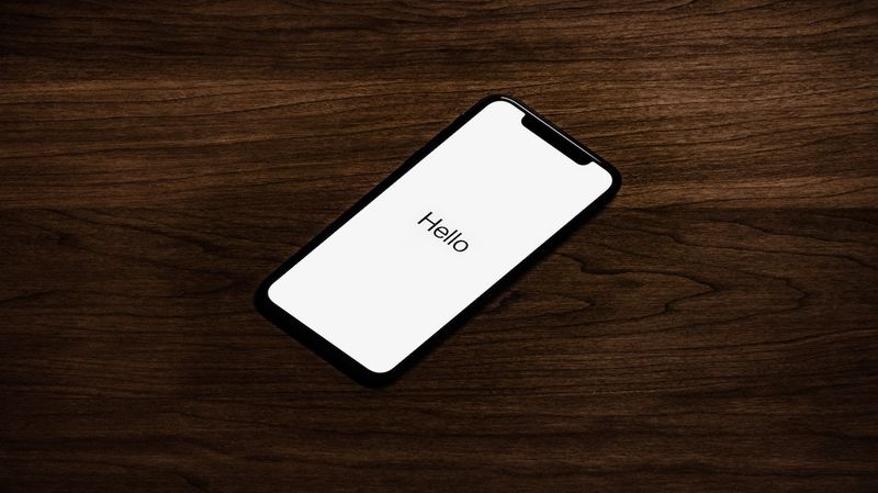 iPhone sitting desk with