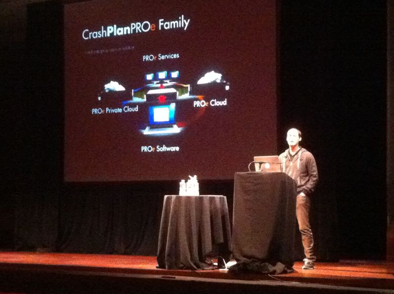 A Code 42 rep stands at a podium during JNUC to explain how to use Jamf Pro with CrashPlan PROe.