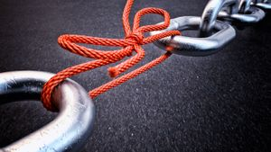 Chain links being held together with string.