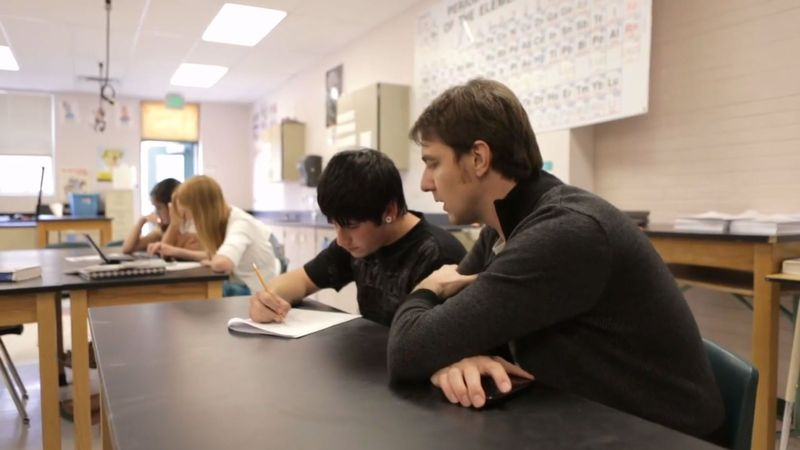 Aaron Sams speaks with a student in his classroom, introducing us to the flipped classroom educational model.