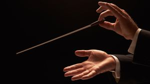 Orchestra conductor's hands demonstrate Security Orchestration with Jamf Pro and Jamf Protect